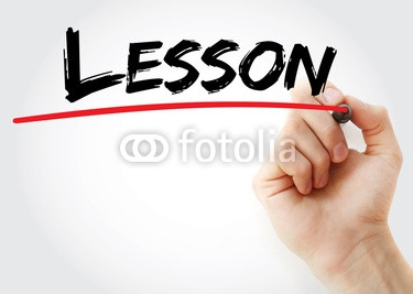 Hand_writing_Lesson_with_marker_business_concept.jpg